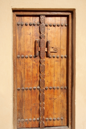 Beautiful ancient door in Riffa fort, Bahrain photo