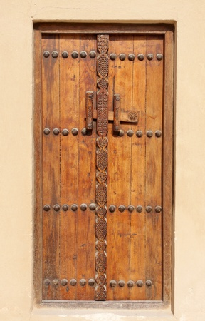 Ancient carved door in Riffa fort, Bahrain Stock Photo - 14354606