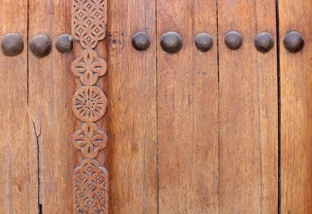 Bolts and beautiful design on ancient door in Riffa fort, Bahrain photo