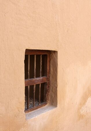 Small window in the wall, inside Riffa fort, Bahrain Stock Photo - 14354593