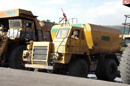 Heavy water tanker to pour water in the mine area Stock Photo