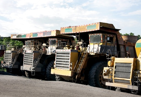 Heavy coal dumpers in a opencast mine photo