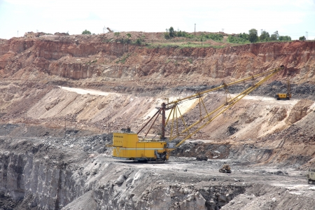 Heavy dragline excavator in a opencast coal mine photo