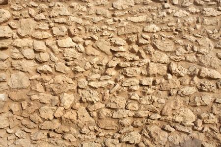 saar: The exposed embedded limestone on the walls of Saar temple