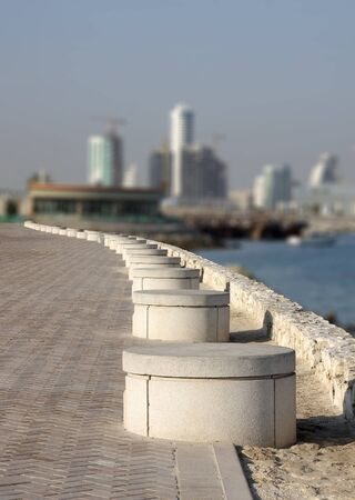 Round benches in a row all along the corniche of Bahrain