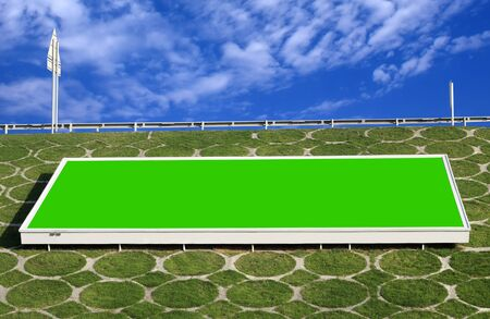 Green billboard to think green placed on the slope of Highway photo