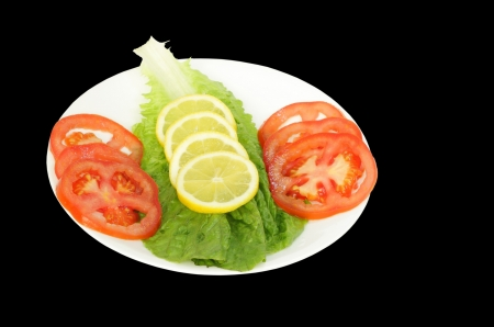 Fresh green Salad with tomato, lemon and lettuce Stock Photo - 14476506
