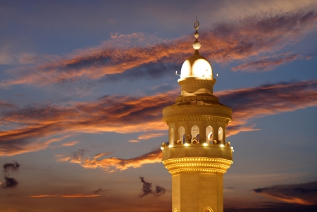 Beautiful view of the top of Al Fateh Mosque Minaret at sunset photo