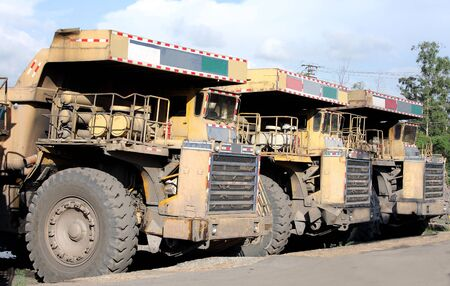 Heavy coal dumpers in a row photo
