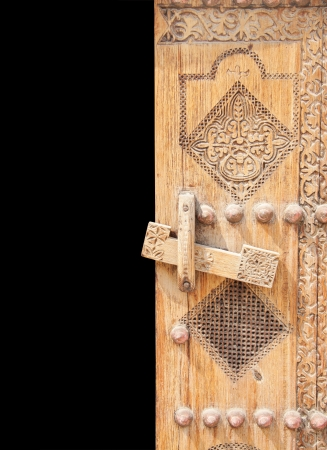 Beautifully carved right half of ancient door photo