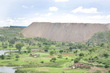 coal mine: Hill formed by the overburden removed from coal mines near a village