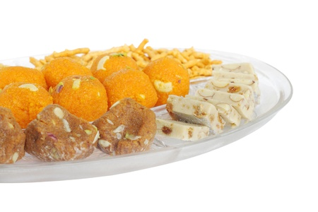 Indian sweets at shallow DOF; focus kept on the middle of the plate