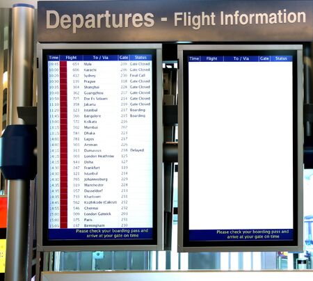 Digital boards with Flight information and a blank board at Dubai Airport Stock Photo