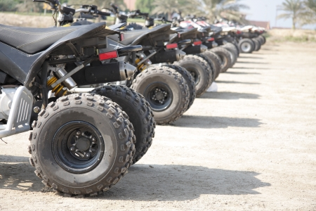 Rear wheel of desert sscooter arranged in a row Stock Photo