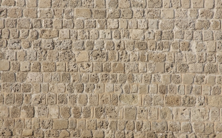 Beautiful coral and limestone brick wall in Bahrain fort Stock Photo