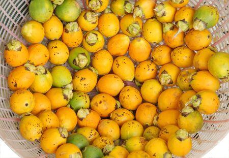 betelnut: Ripe areca nut kept for drying Stock Photo