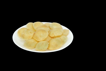 pani: Puri of panipuri kept on a plate isloated on black