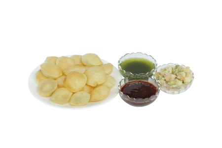 pani: Panpuri with tarter water, sweet red sauce, potato and chickpeas