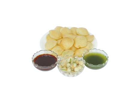 Tarter water, sauce, mashed potato and chickpeas with panipuri photo