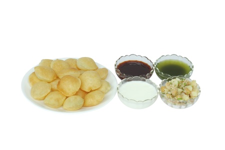 pani: Panpuri with sweet red sauce, yogurt, potato and chickpeas Stock Photo