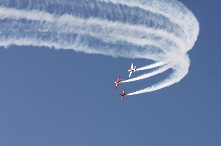 MUHARRAQ, BAHRAIN - DECEMBER 17: Stunts pilots from The Champions Aerobatic Show (TCAS) perform on December 17, 2011 on the occasion of Bahrain 40th National Day at Busaiteen beach in Muharraq, Bahrain Editorial