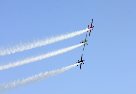 MUHARRAQ, BAHRAIN - DECEMBER 17: Stunts pilots from The Champions Aerobatic Show (TCAS) perform on December 17, 2011 on the occasion of Bahrain 40th National Day at Busaiteen beach in Muharraq, Bahrain