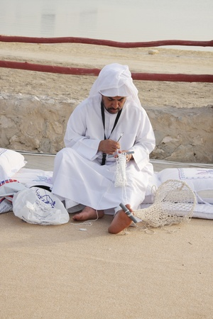 generates: MANAMA, BAHRAIN - APRIL 29: An expert generates pearl divers oyster collection bag inside Arad Fort heritage village  on April 29, 2011 on the occasion of Annual heritage festival Pearl Glitter 2011 in Manama, Bahrain Editorial