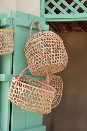 chicken cage: Beautiful date palm leaves woven basket and birds cage Stock Photo