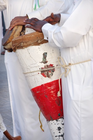Traditional conical hand-drum played by a pearler photo
