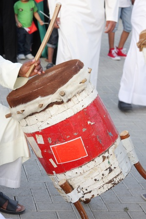 Traditional drum played by artist with vocal music Fijiri photo
