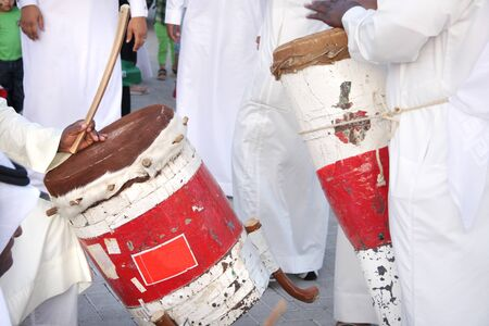 Colorful traditonal drums played by artists with pearl song photo