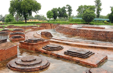 sarnath: Votive Stupas relics around the Dharmarajika Stupa at Sarnath, India