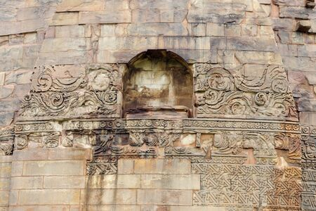 sarnath: Floral and geometric carvings on Dhamekh Stupa at Sarnath, India  Stock Photo