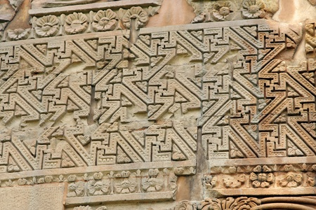 sarnath: Close view of geometric carvings on Dhamekh Stupa at Sarnath, India