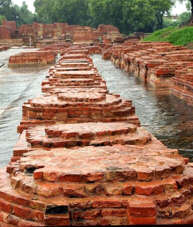 vihar: Array of miniature buddhist stupas ruins