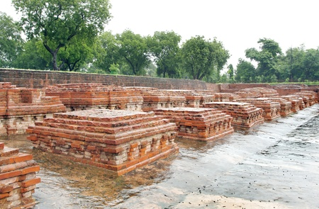 sarnath: Group of square miniature buddhist stupas ruins Stock Photo
