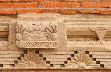 vihar: Wall with beautiful sandstone carving and burnt bricks