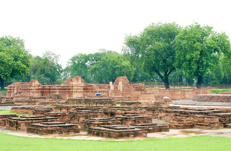 Miniature votive stupas and the Mulagandhakuti ruins at Sarnath Stock Photo - 17429991