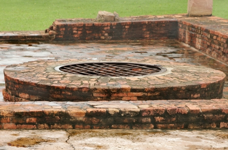 sarnath: Close view of ancient well at monastery ruins site, Sarnath