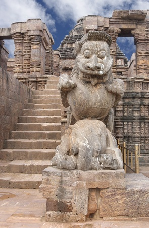 Giant lion at the entrance of sun temple Konark on clear sky photo
