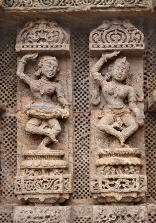 Beautiful carved lady dancer and a musician photo