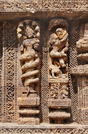 A Snake hooded sculpture and an amorous couple, Sun temple, Konarak Stock Photo - 18177176