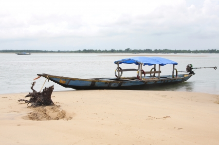 chilika: A boat anchored with a wooden root in an island of Chilika lake, Orissa India