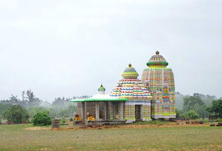 rainfall: Rainfall on a colorful temple on Puri-Konark highway orissa, India