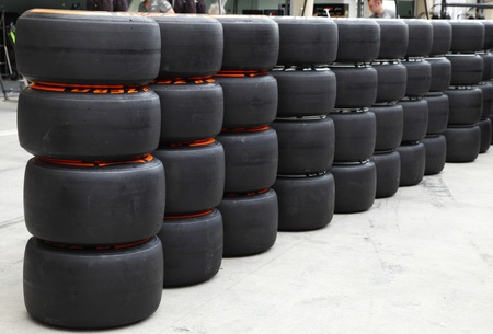 SHAKIR, BAHRAIN - APRIL 18: Heap of Formula 1 vehicle tyres in front of Pit stop garage on Thursday April 18, 2013, Formula 1 Gulf Air Bahrain Grand Prix 2013 Editorial