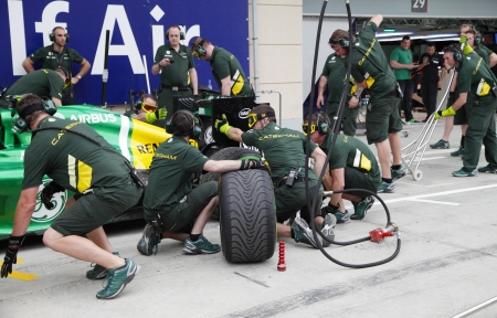 prix: SHAKIR, BAHRAIN - APRIL 18: Team Caterham-Renault doing practice of changing tyres and refuelling in front of Pit stop garage on Thursday April 18, 2013, Formula 1 Gulf Air Bahrain Grand Prix 2013