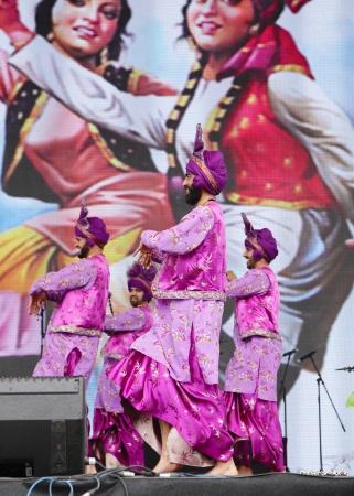 mesmerising: SHAKIR, BAHRAIN - APRIL 19: Bhangra Empire troupe of India performs at Formula 1 village, vending area & entertainment in 2013 Formula 1 Gulf Air Bahrain Grand Prix on April 19, 2013 in Shakir, Bahrain Editorial