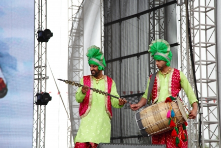 mesmerising: SHAKIR, BAHRAIN - APRIL 19: Bhangra Empire troupe of India performs at Formula 1 village, vending area & entertainment in 2013 Formula 1 Gulf Air Bahrain Grand Prix on April 19, 2013 in Shakir, Bahrain Editorial