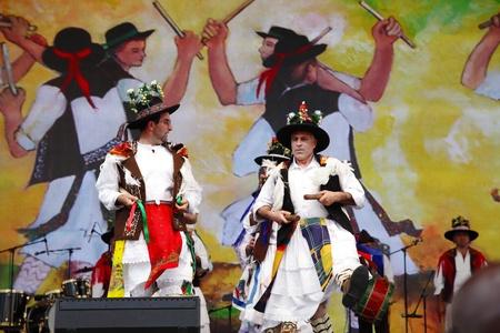 mesmerising: SHAKIR, BAHRAIN - APRIL 19: Portugal�s Pauliteiros de PalaCoulo dancers performs at Formula 1 village, vending area & entertainment in 2013 Formula 1 Gulf Air Bahrain Grand Prix on April 19, 2013 in Shakir, Bahrain