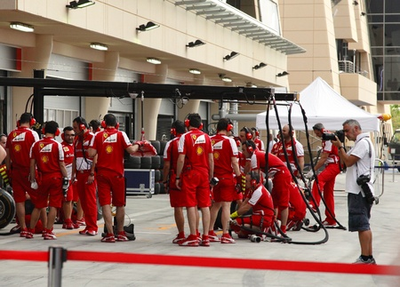 SHAKIR, BAHRAIN - APRIL 18: Team Ferrari ready to do practice of changing tyres and refuelling in front of Pit stop garage on   Thursday April 18, 2013, Formula 1 Gulf Air Bahrain Grand Prix 2013 Editorial